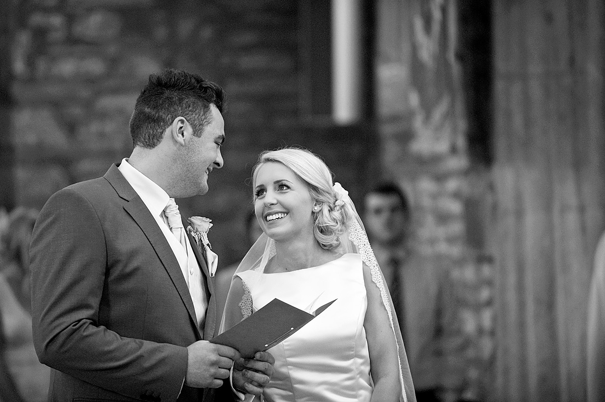 Bride and groom looking at each other during Devon church wedding
