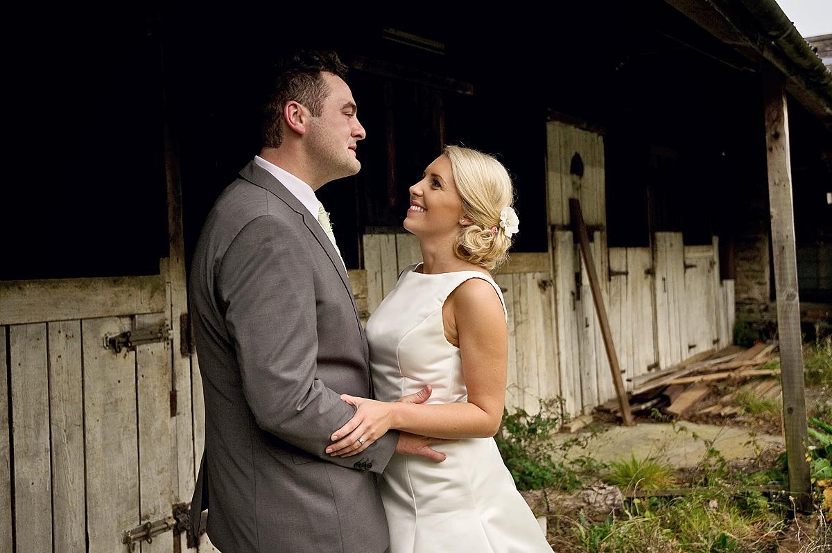 Bride and groom looking into each other eyes on Dartmoor farm wedding