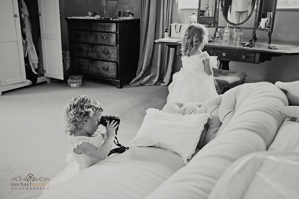 Flowergirl taking photos in Axnoller House Dorset