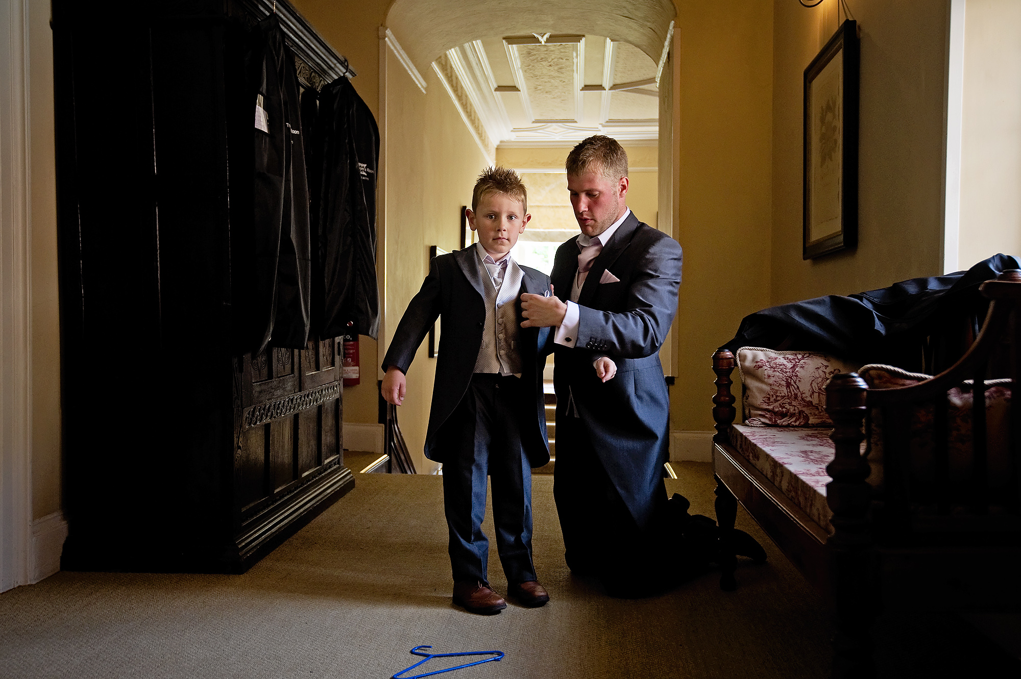 Pageboy getting dressed at Langdon Court wedding