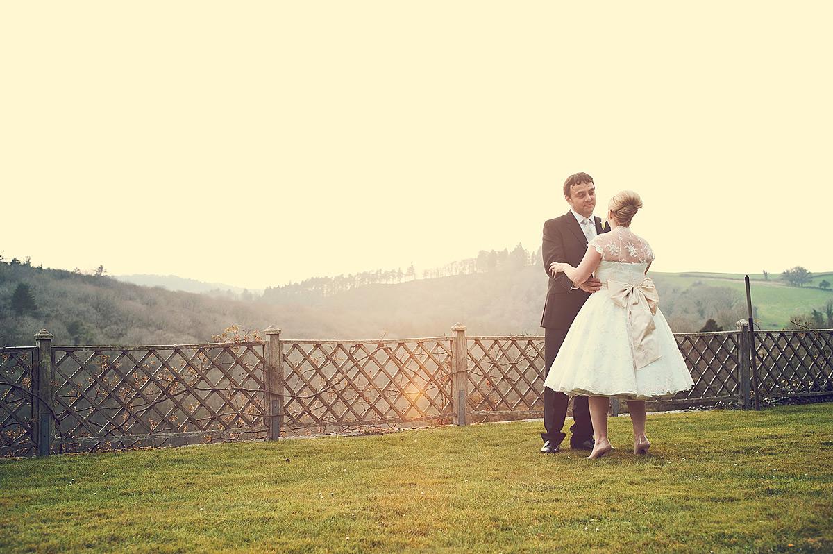 Bride and groom on garden terrace at Hotel Endsleigh in devon