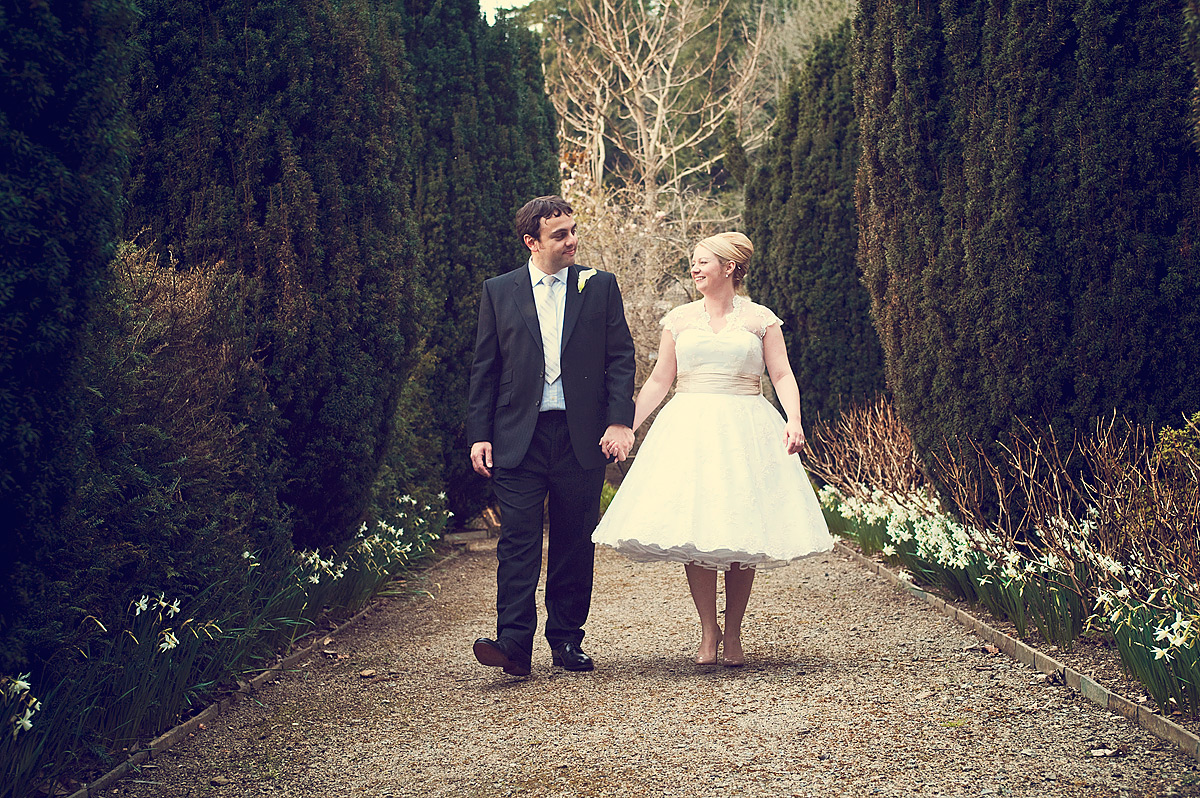 Wedding couple walking hand in hand at Hotel Endsleigh