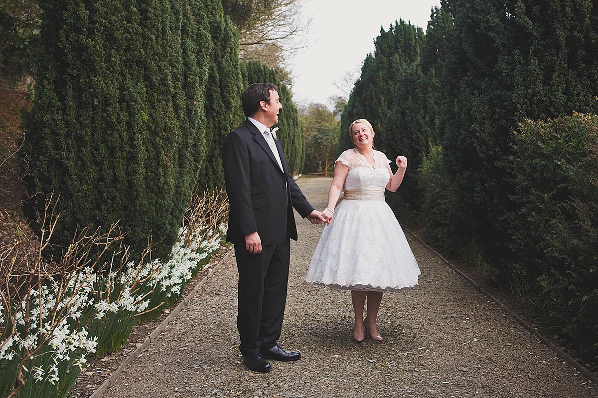 Vintage bride and groom in walk at Hotel Endsleigh