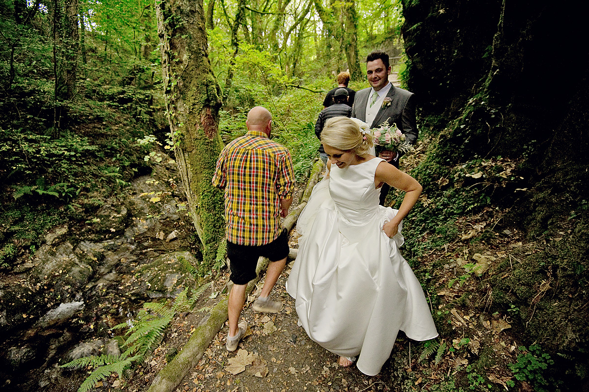 Bride and groom pass walkers on Lydford Gorge footpath