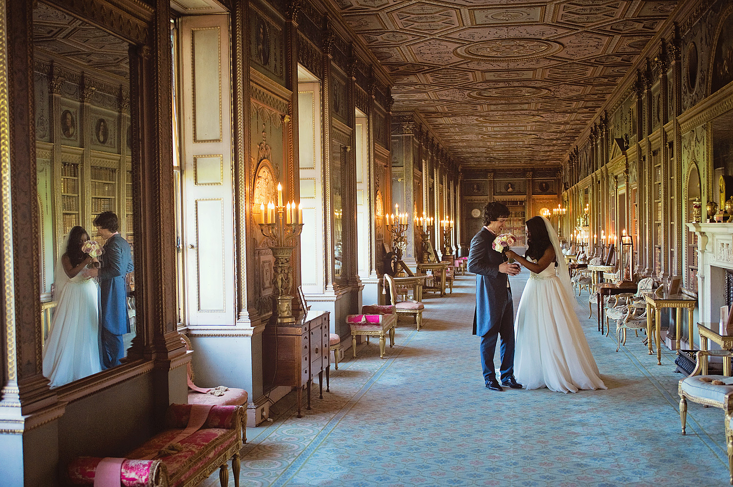 Bride and groom talking in long gallery at Syon House.