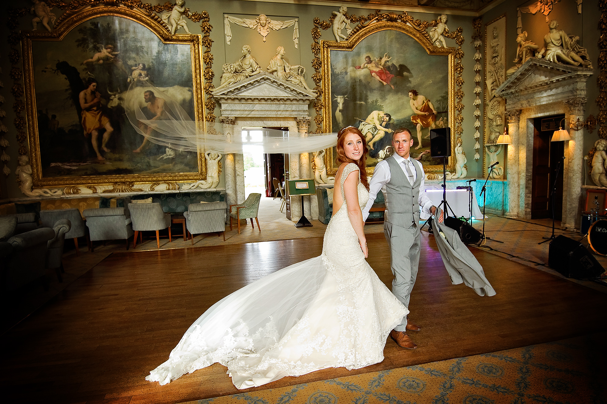 Bride and groom in main hall of luxury London wedding venue Moor Park.