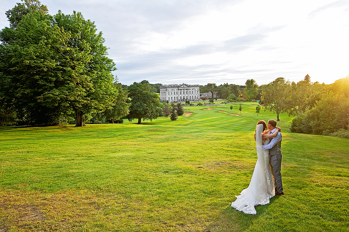 Bride and groom look over Moor Park mansion from the 18th tee