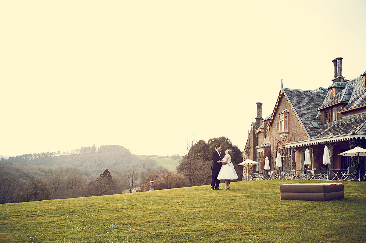 Wedding couple in front of Hotel Endsleigh