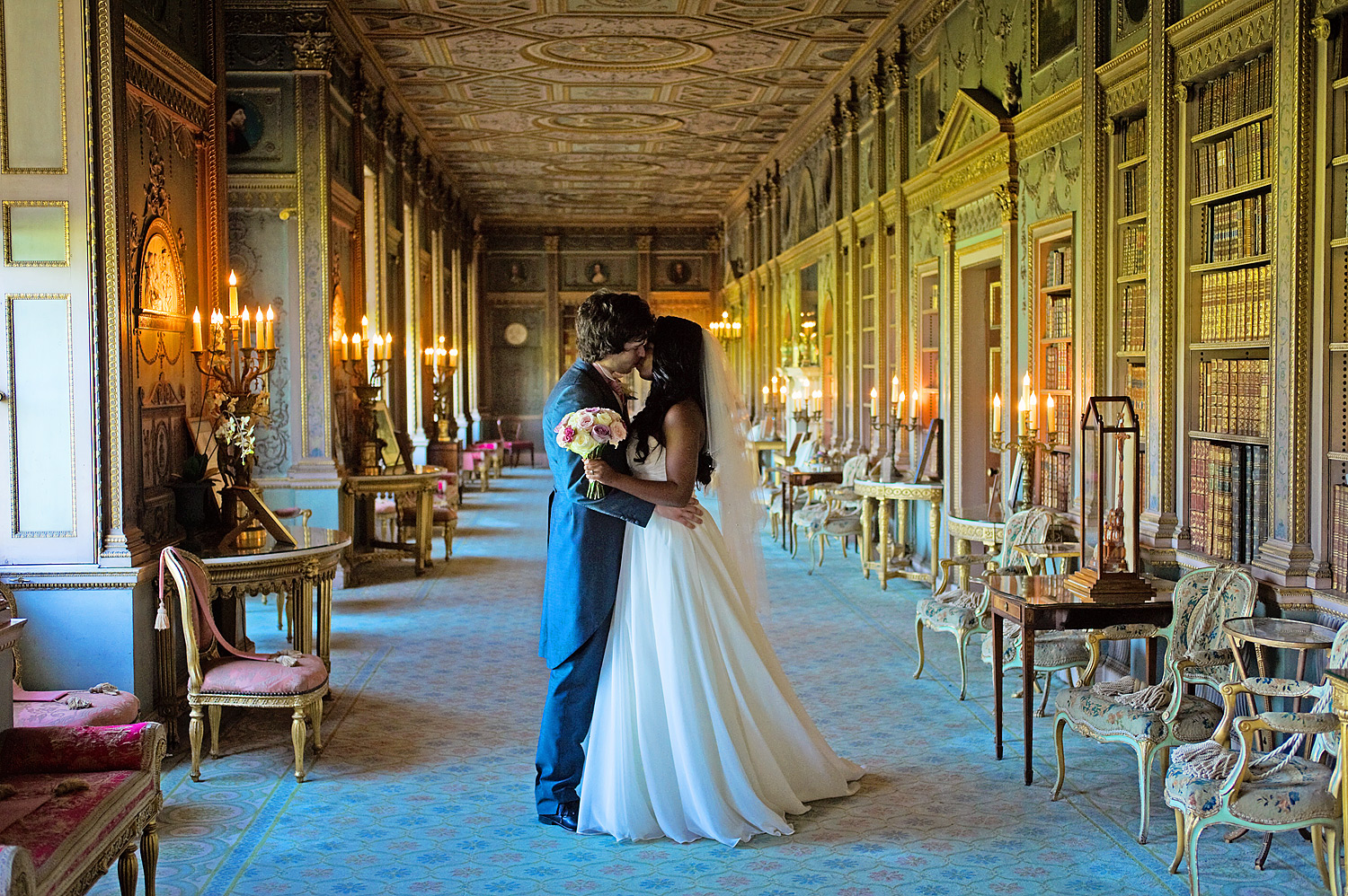Bride and groom kiss in Syon House long gallery