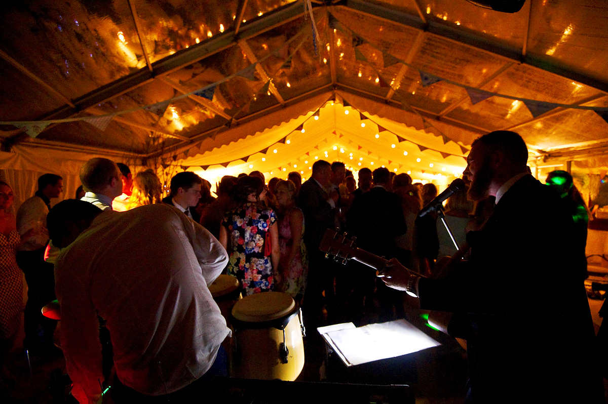 Night photo of wedding party celebrations as band play