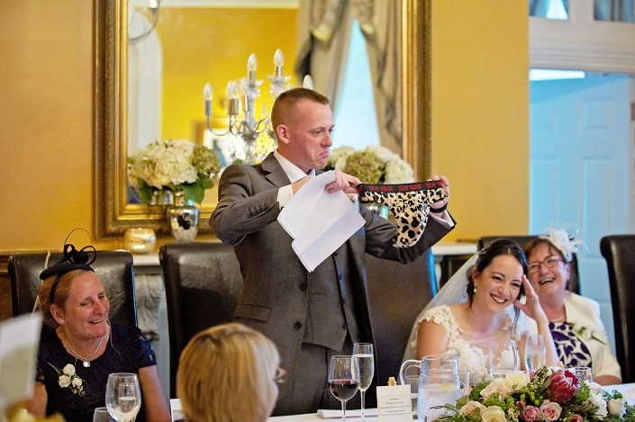 Funny moment of groom holding up sexy beast pants during his speech.
