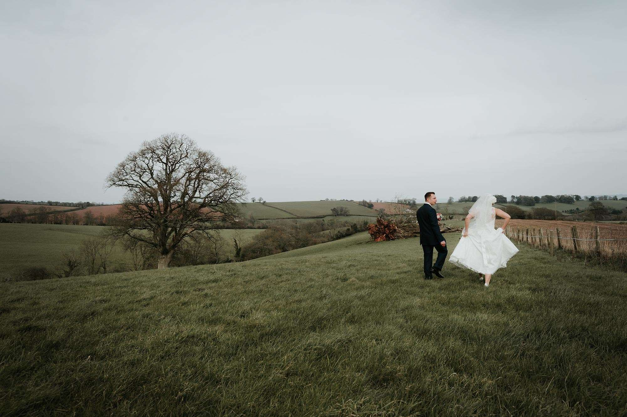 Haldon farm wedding couple walking in the field near Exeter