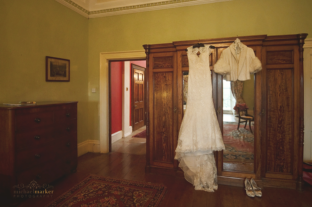 Brides wedding dress hanging up at Buckland House in Devon