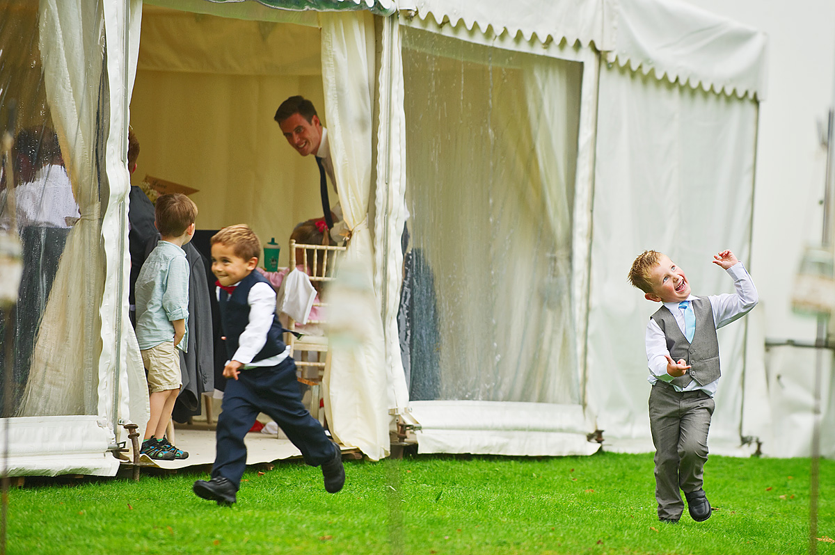 Young children play outside wedding marquee