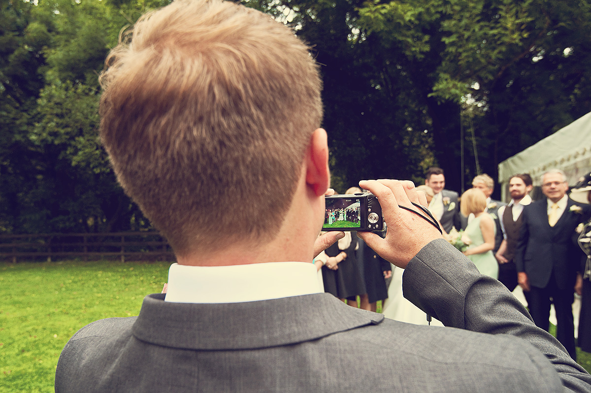 Dartmoor wedding guest takes photo of wedding group