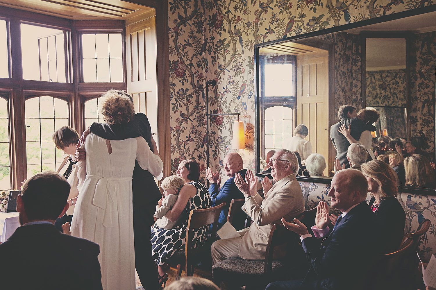 Bride and groom kiss during wedding ceremony at Hotel Endsleigh in Devon