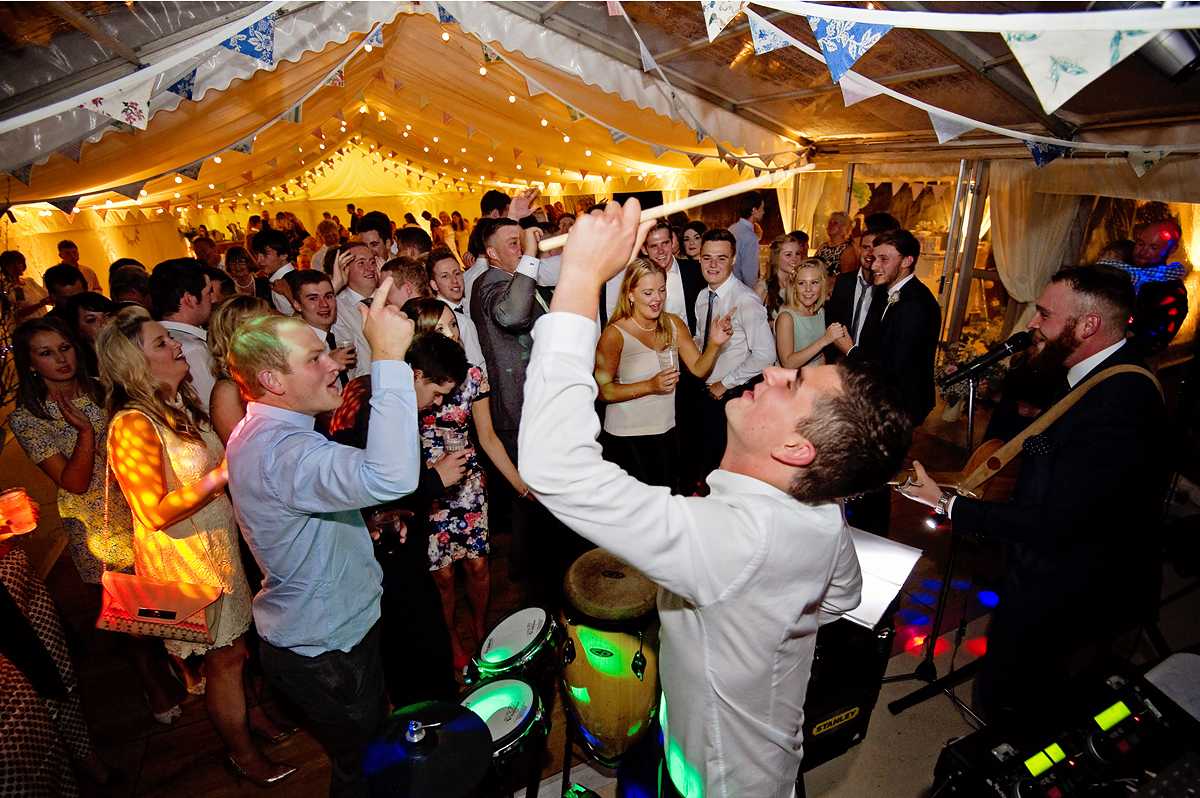 Band play during wedding reception and guests dance