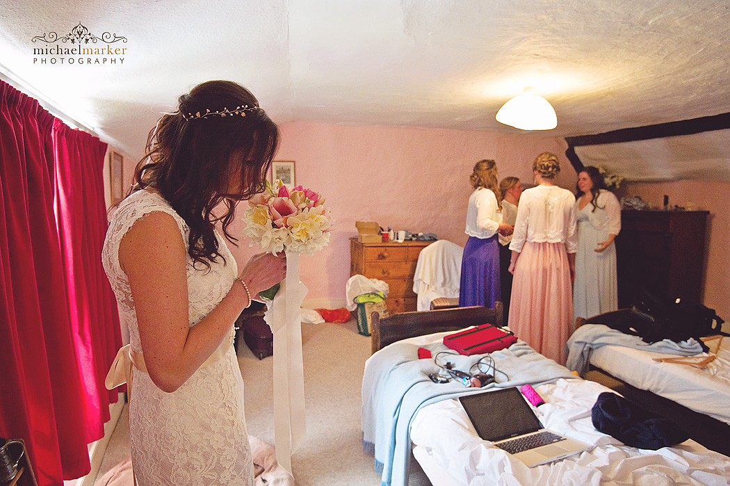 bride smells her fragrant wedding bouquet.