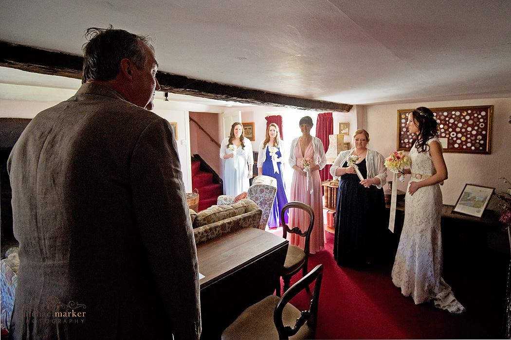father of the bride sees his daughter in wedding dress for first time on her wedding day.