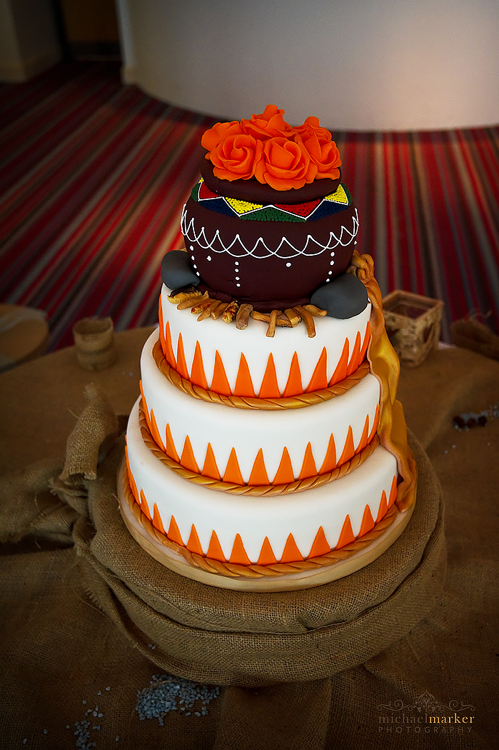 African themed wedding cake with Orange and white.