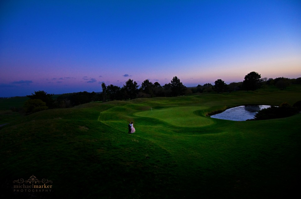 Bride and groom on 18th hole at St Mellion wedding