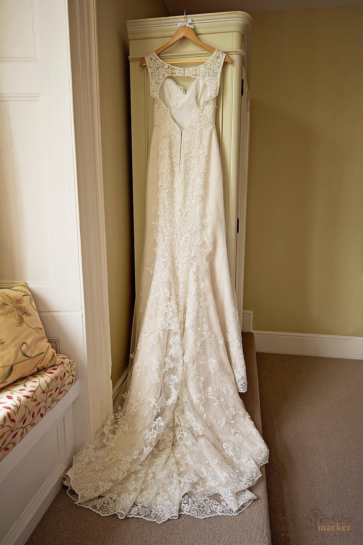 Beautiful lace wedding dress hanging up