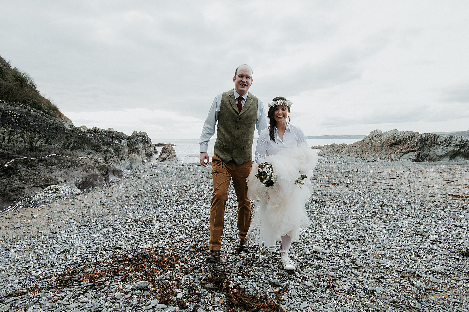 Bride and groom on beach at Polhawn wedding