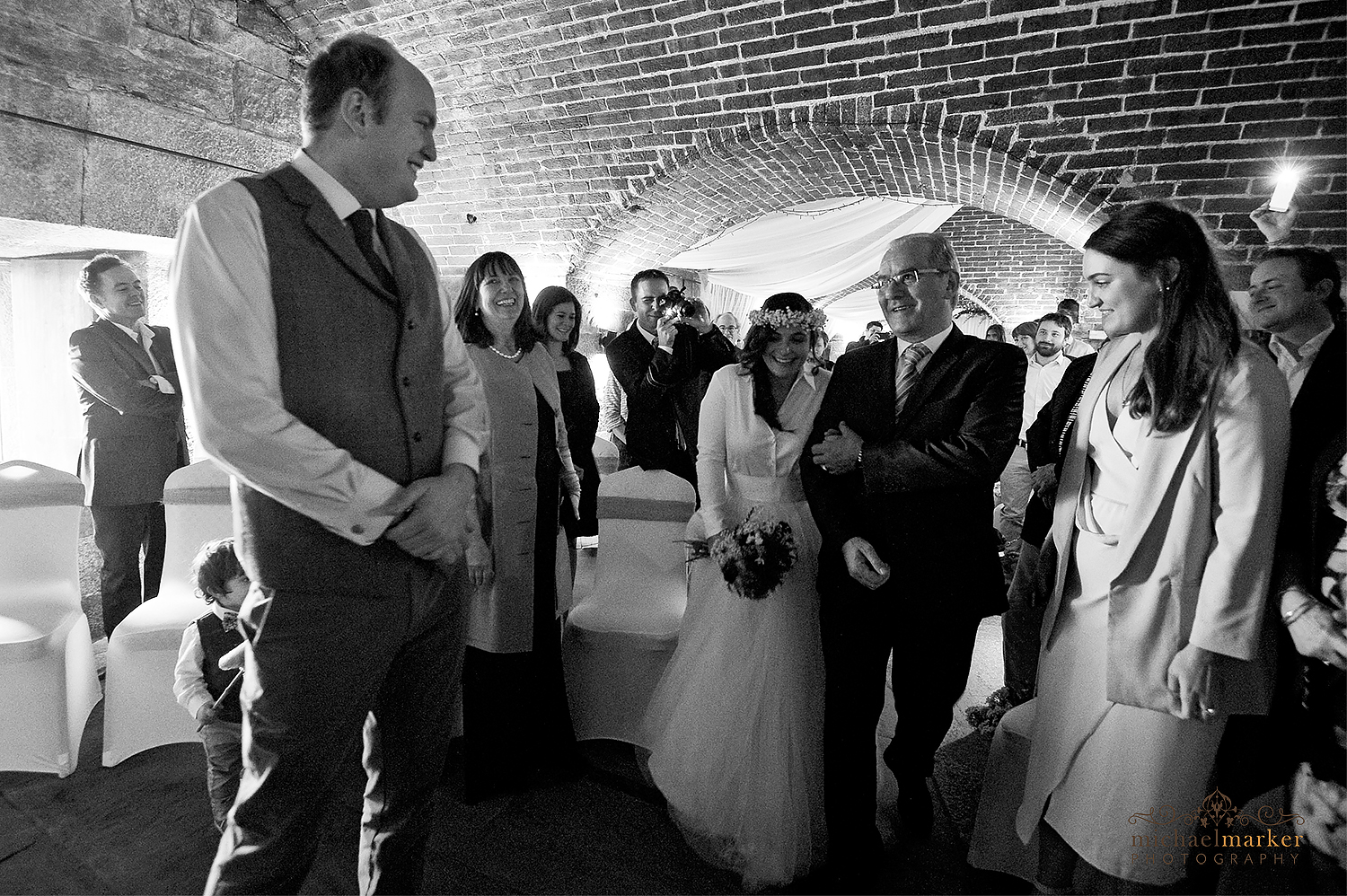 bride and groom's first look at Polhawn fort wedding in Cornwall