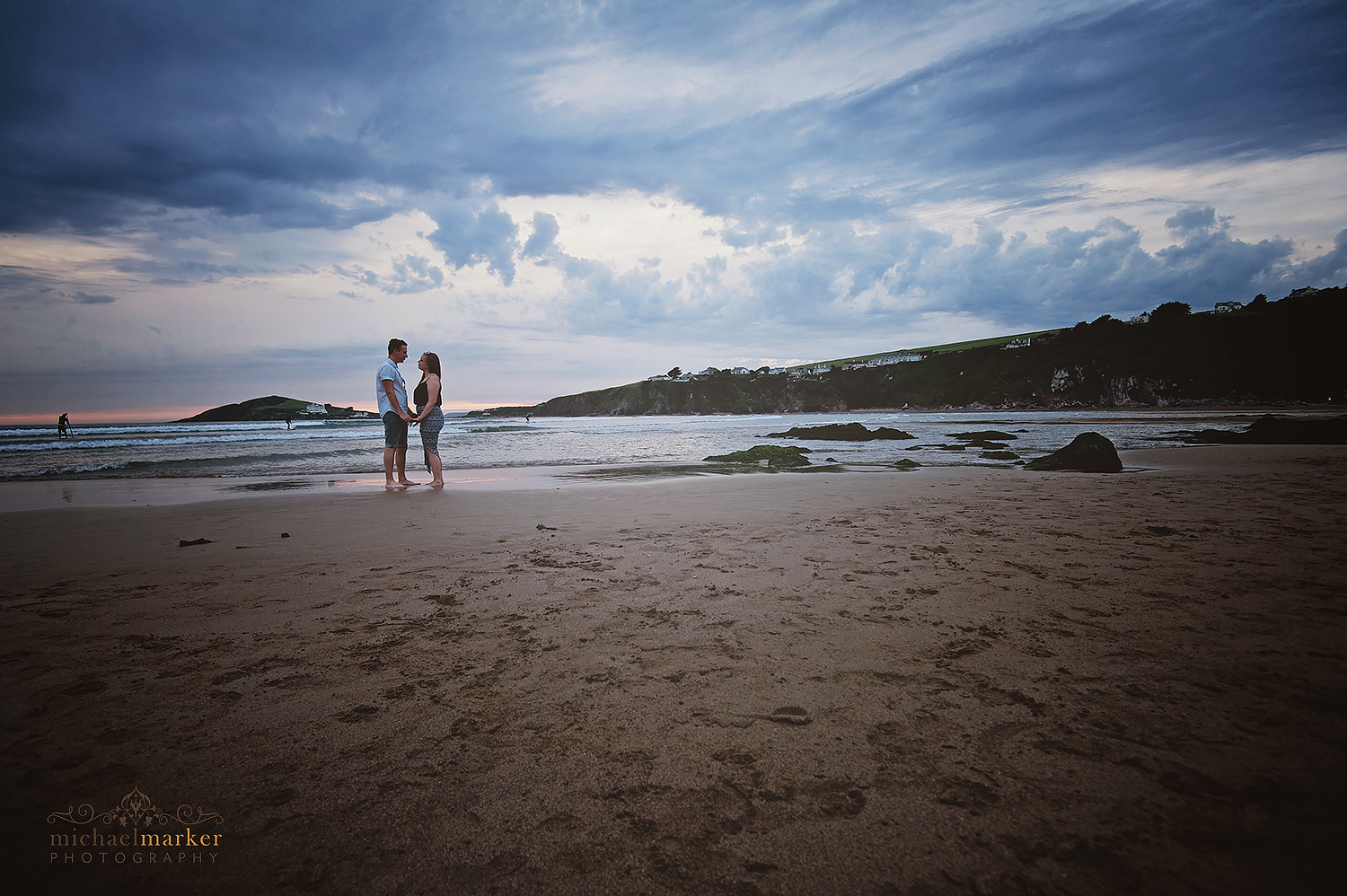 loving-engaged-couple-at-bigbury-beach