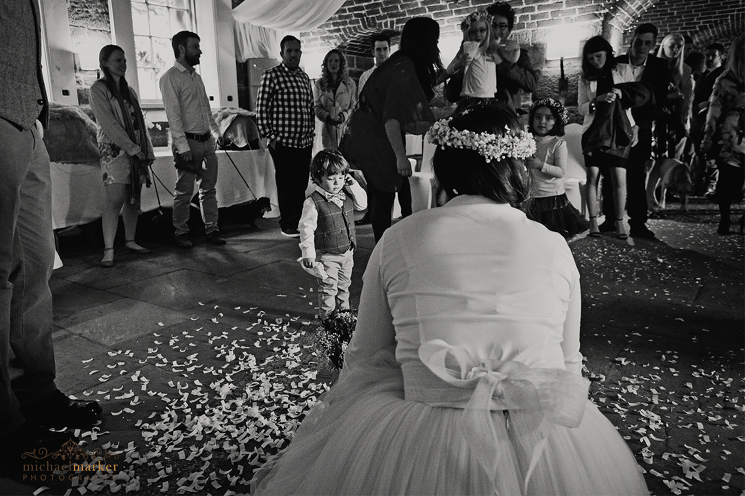 Bride and pageboy inside Polhawn in black and white