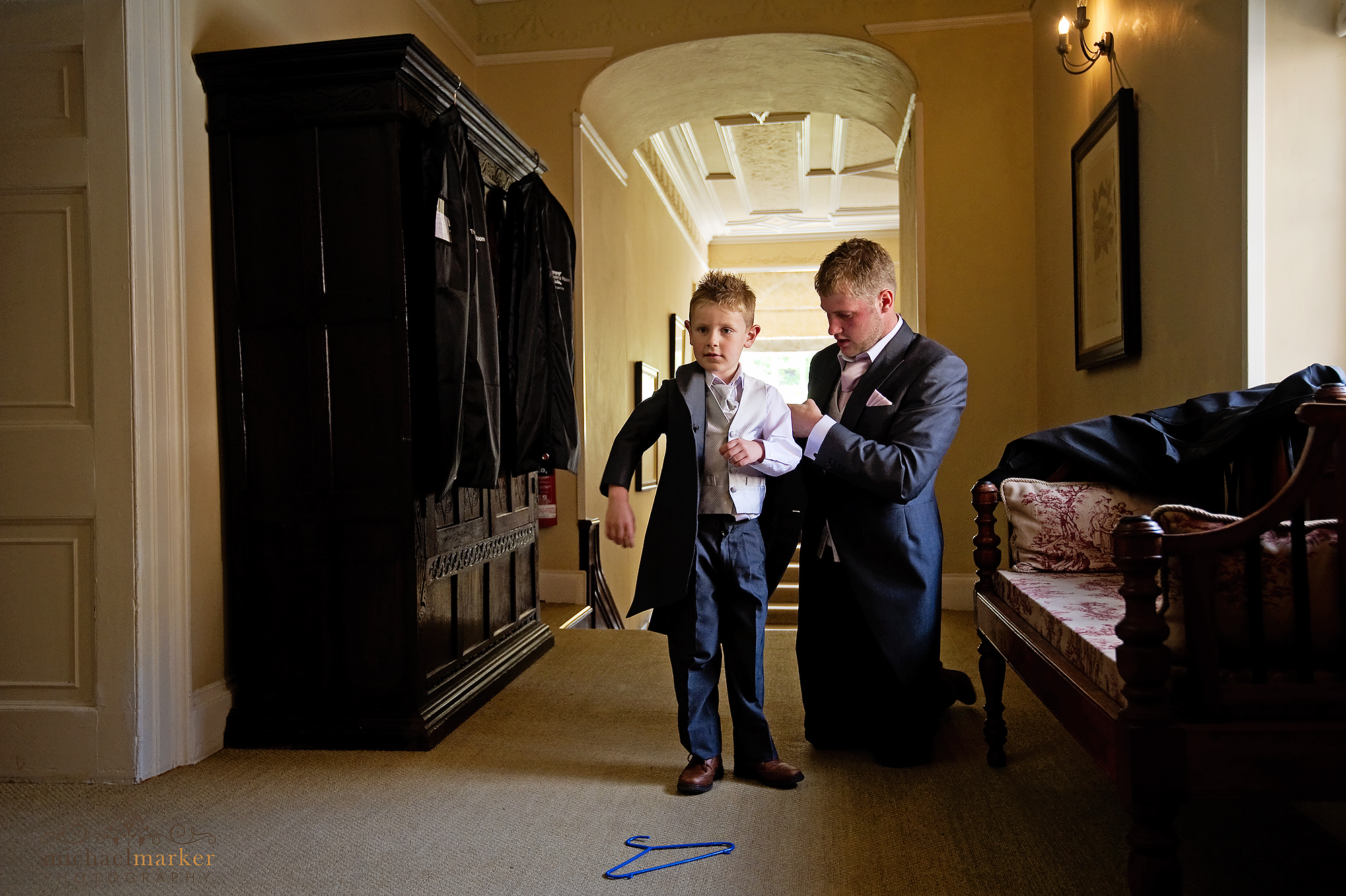 Page boy getting ready at Langdon court hotel devon