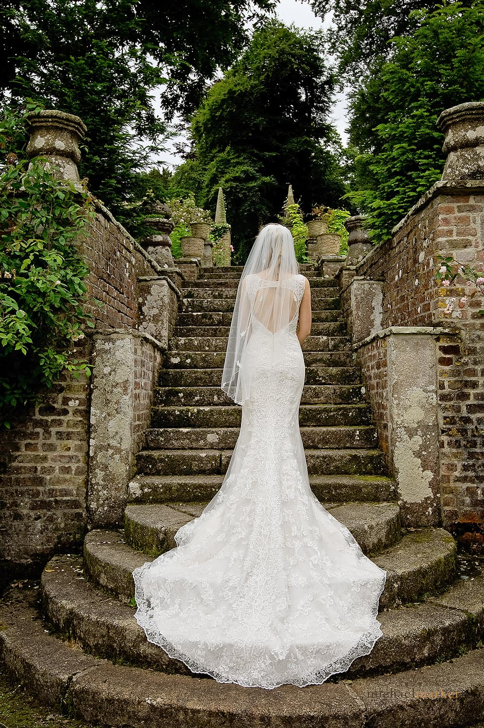 Beautiful bride on steps at Langdon court