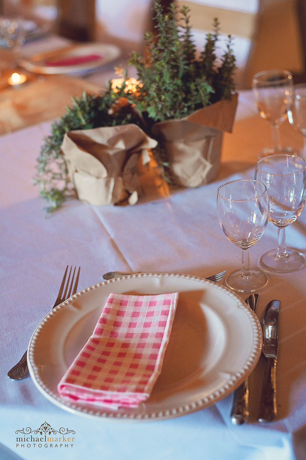 red gingham place setting and herb decoration