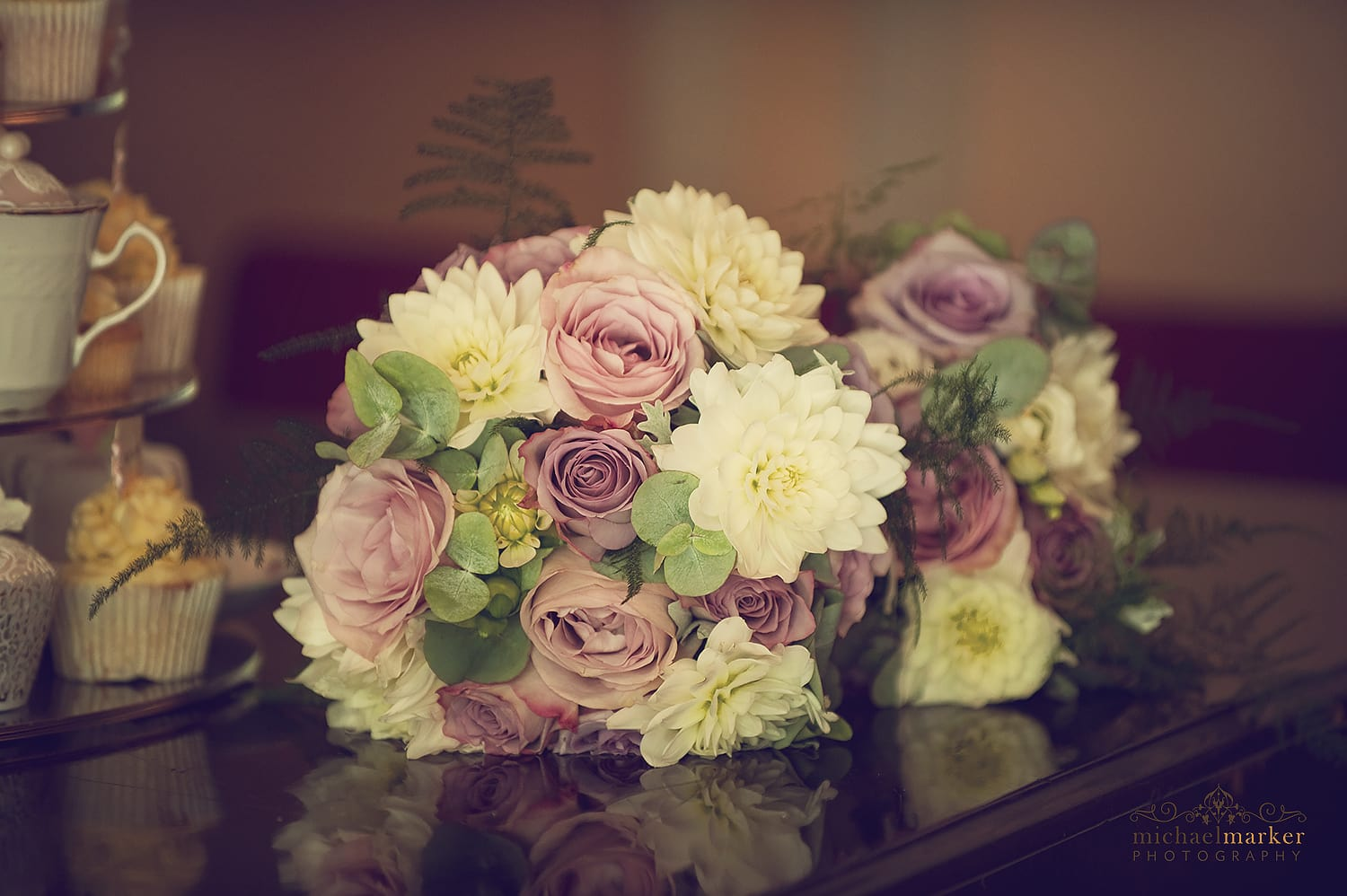 wedding bouquet of flowers on a grand piano.