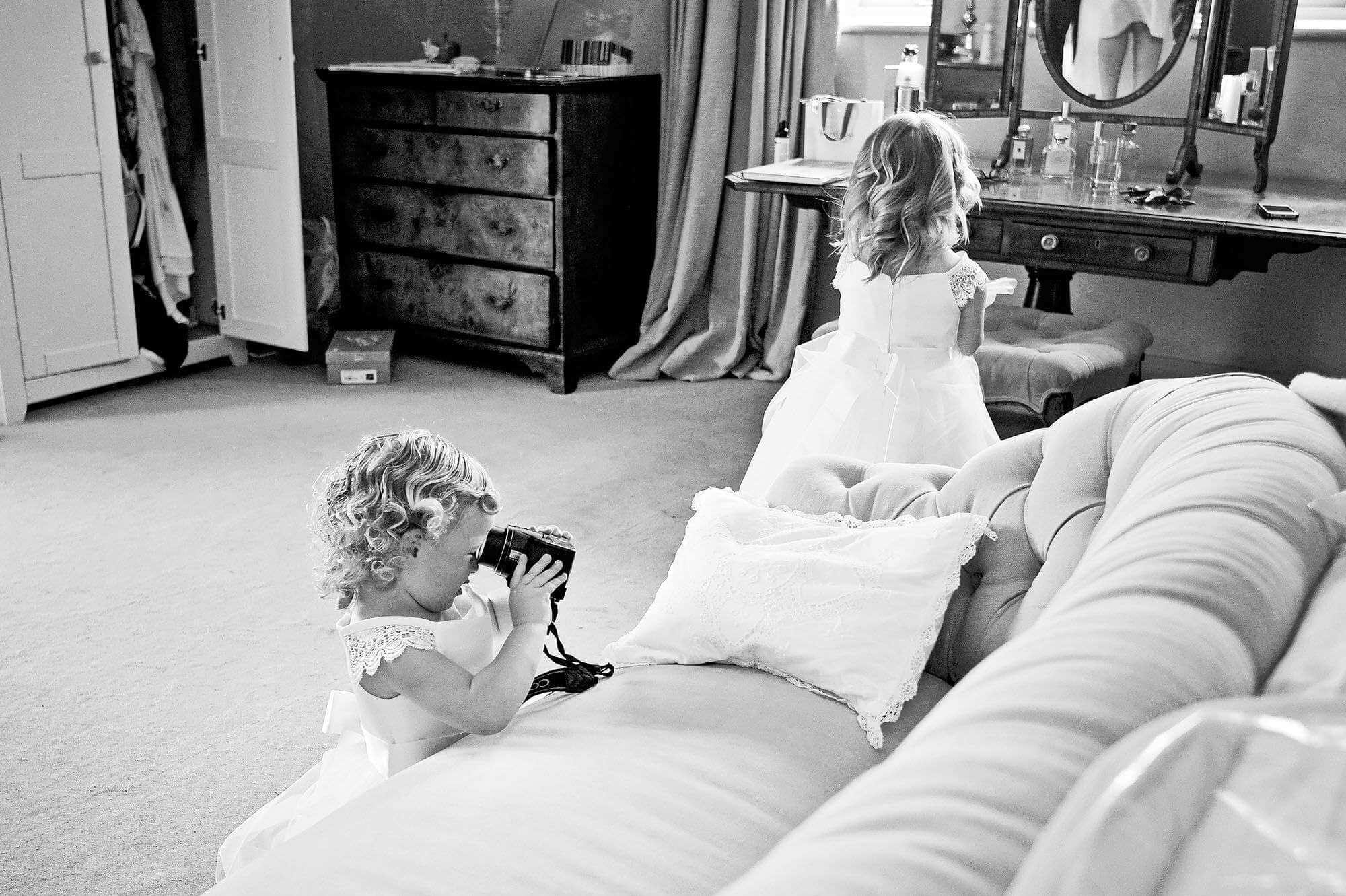Flowergirl playing with a camera