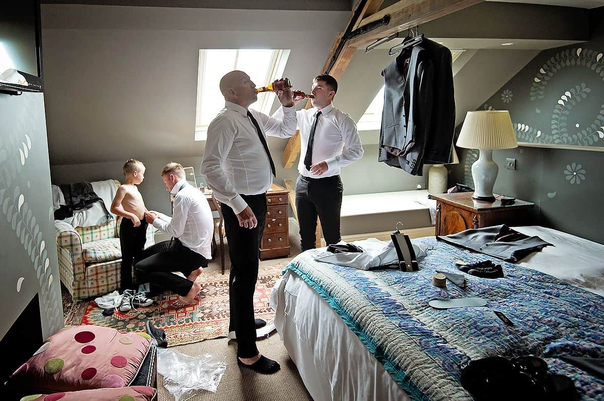 Award winning wedding photo of guys getting ready before the wedding