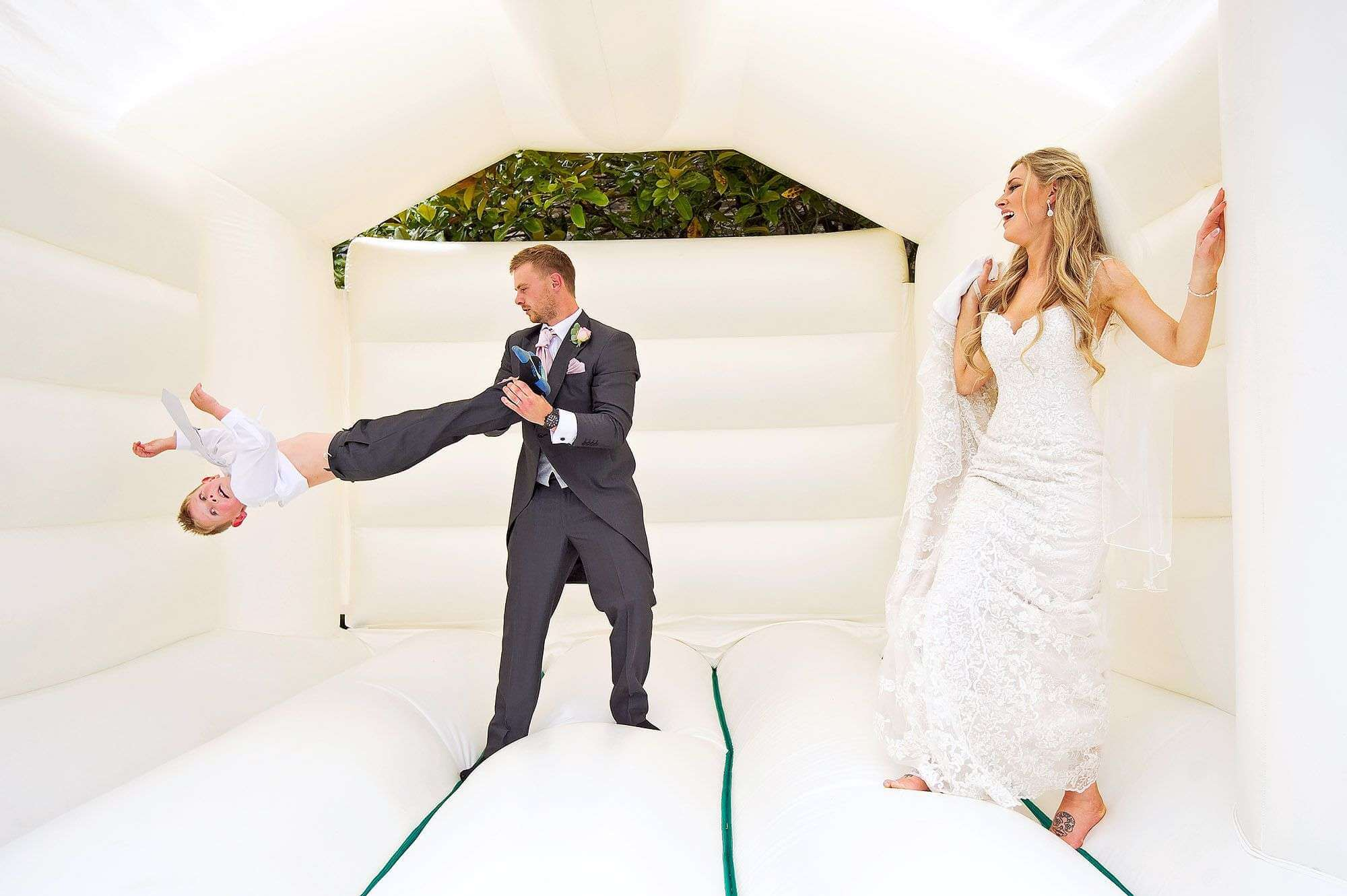 Fun on a bouncy castle on wedding day