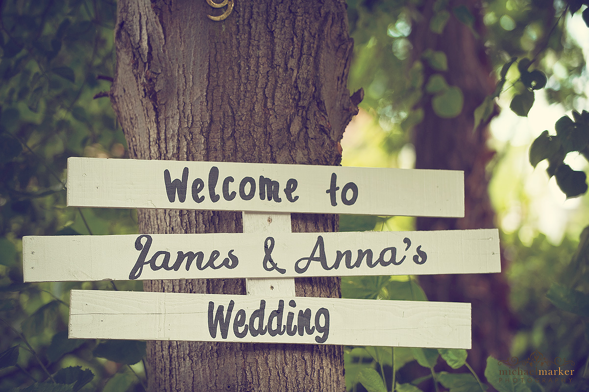DIY wedding sign attached to a tree