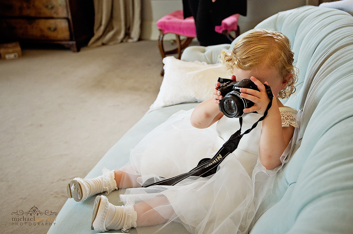 Children taking photos at wedding day in Dorset