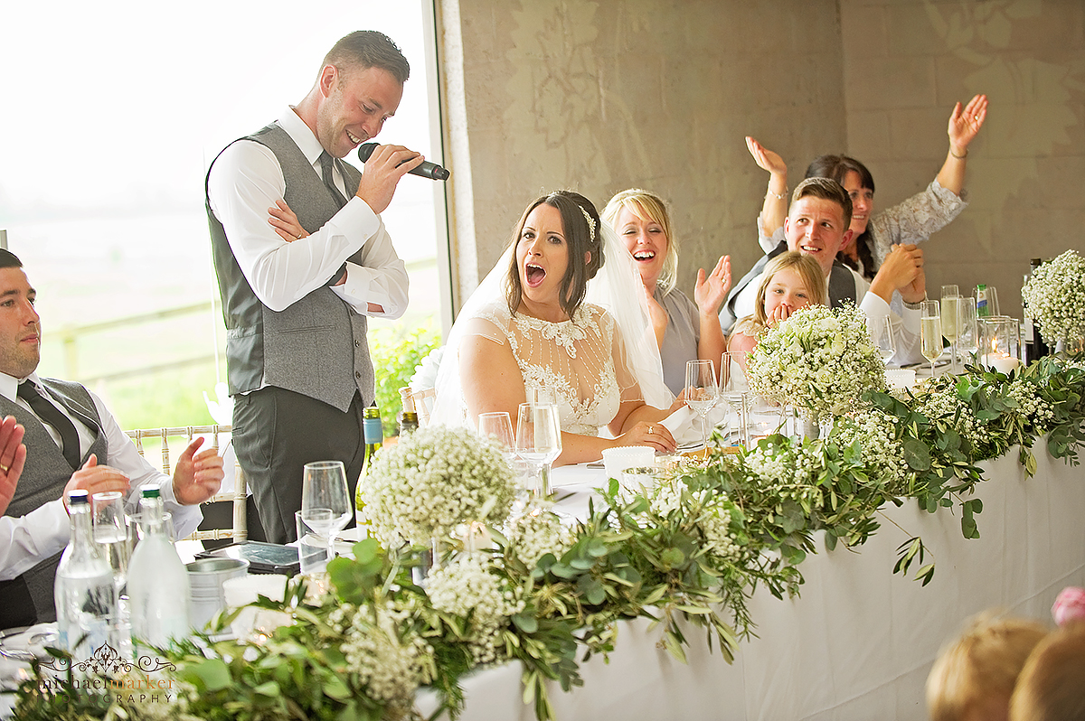 Shocked look of bride during bestman speech