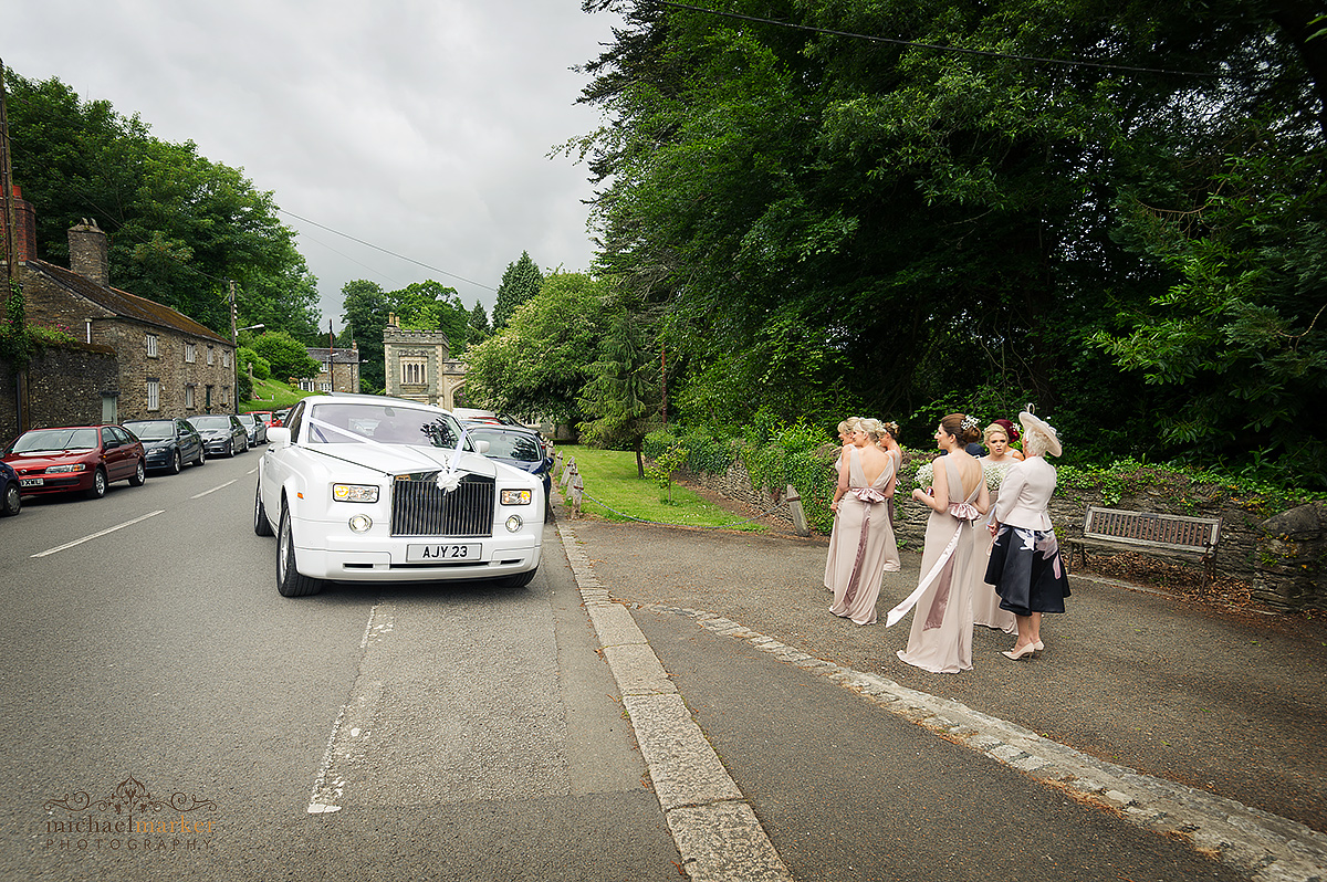 White Rolls Royce wedding car arrives at St Germans Church in Cornwall