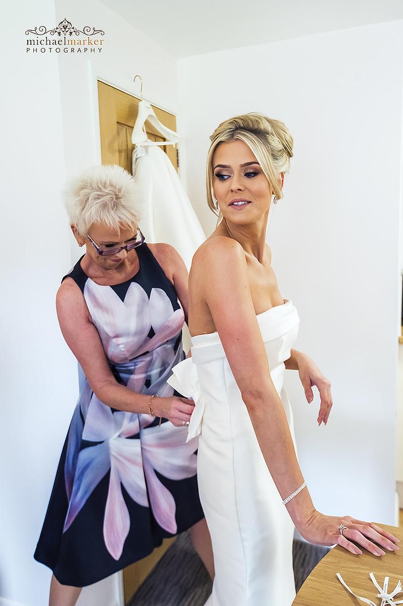 mother-doing-up-wedding-dress - Devon Wedding Photography - London ...
