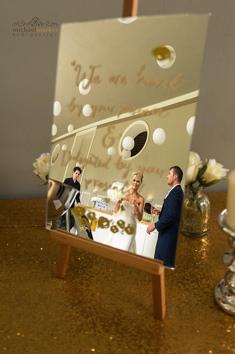 mirror wedding sign and seating plan