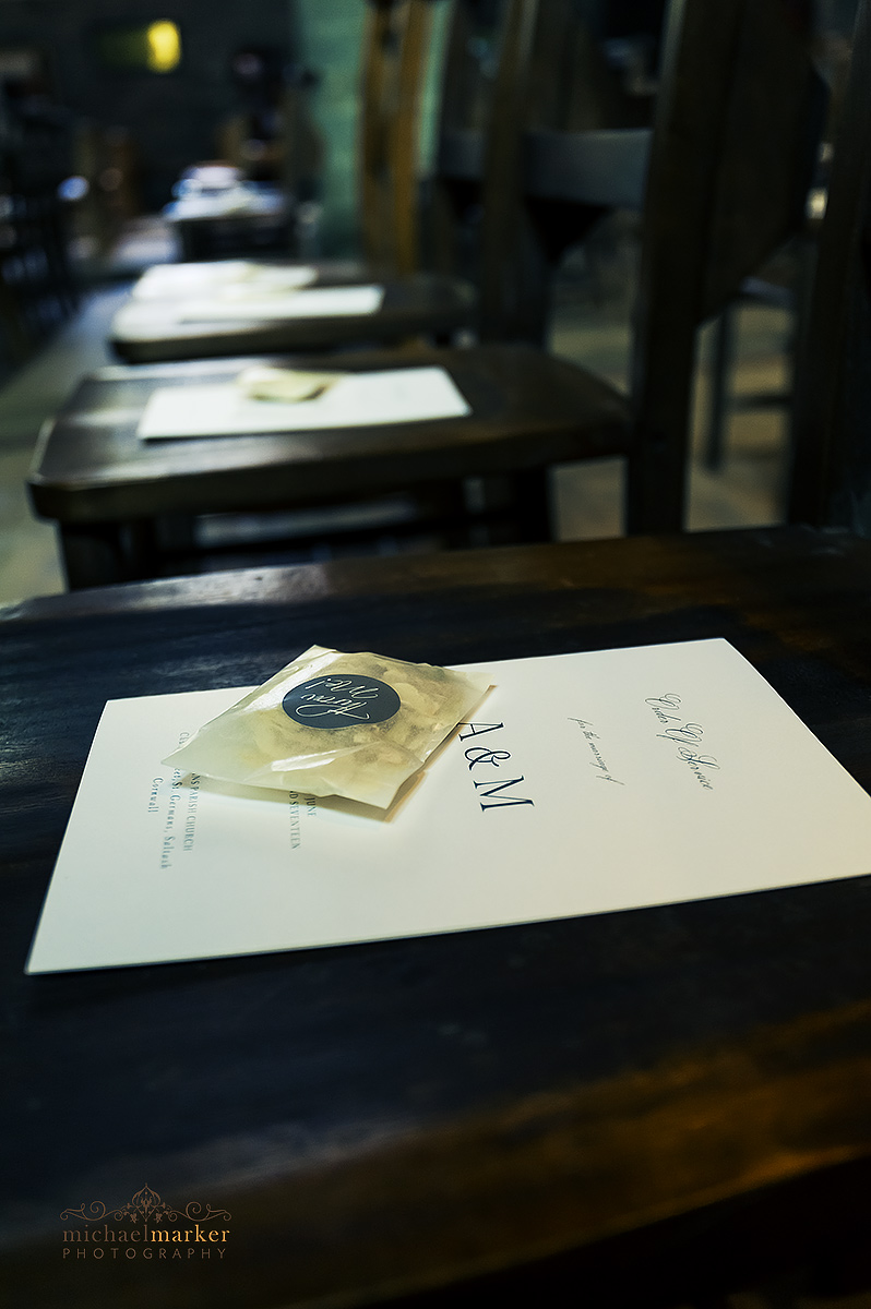 Wedding order of services on seats in St Germans Church interior