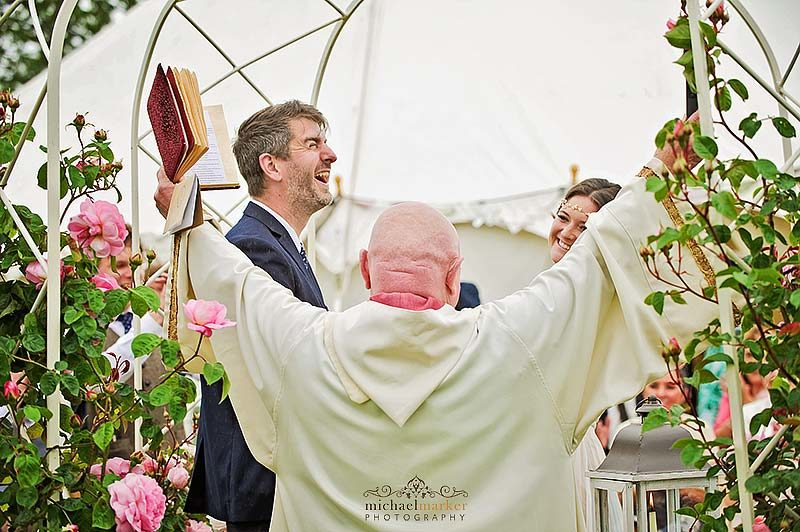 Vicar and groom celebrate wedding vows at Devon outdoor wedding