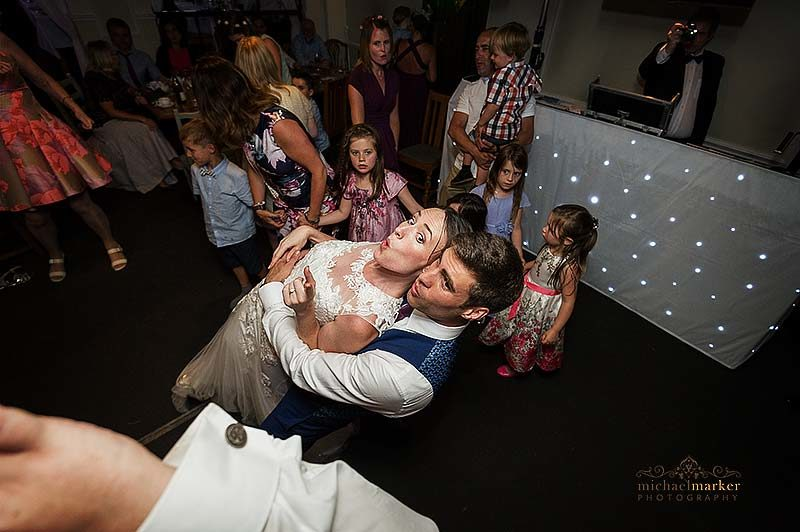 Bride and groom celebrate on the dancefloor at wedding in Salisbury