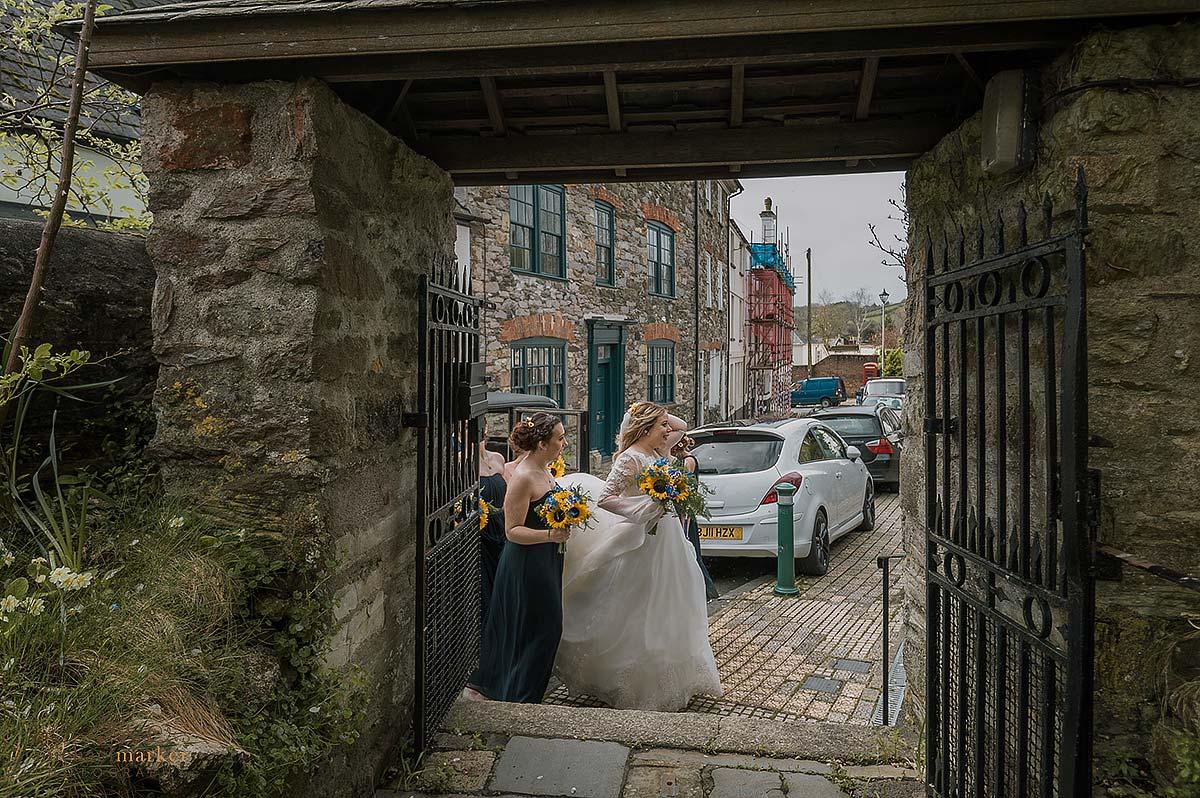 Bride and bridesmaids arrive at plympton Church in devon.