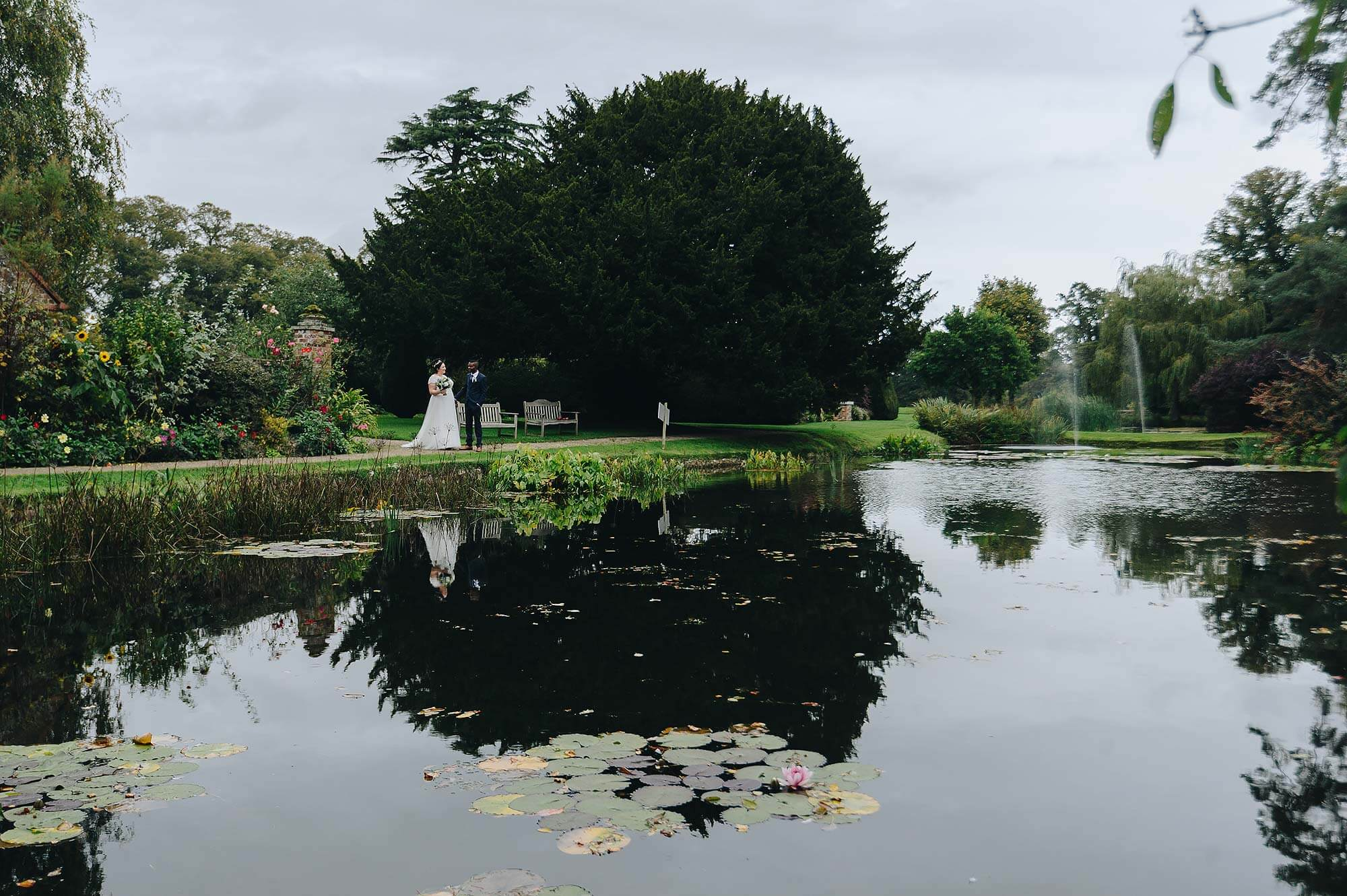 Couple at lake at Cadhay House wedding