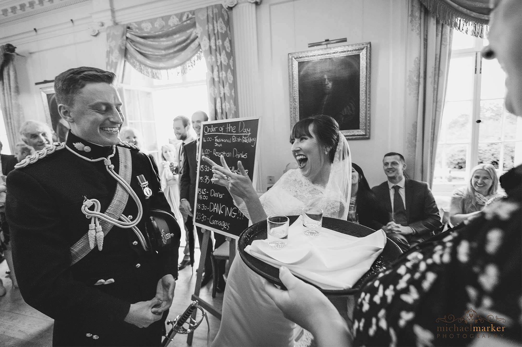 Bride wins a wedding day drinking challenge at Pentillie Castle in Cornwall.
