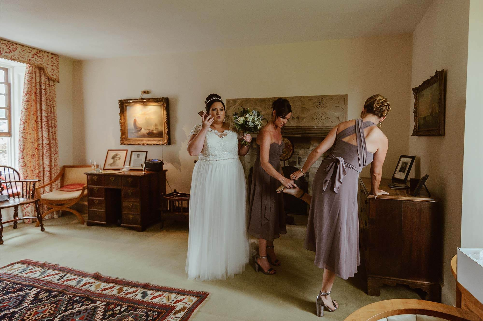 Bride and bridesmaids getting ready at Cadhay House in Devon.